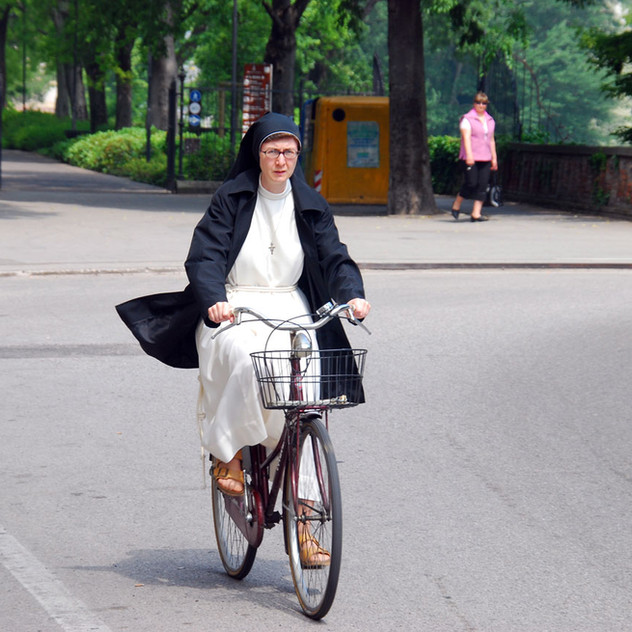 Nun Riding a Bike