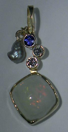 18k sapphire ethiopean opal pendant.JPG