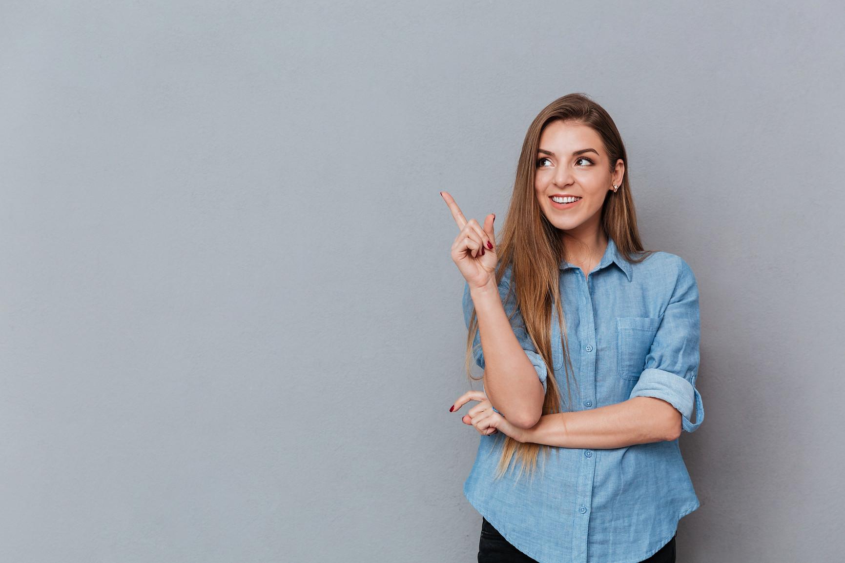 smiling-woman-in-shirt-posing-in-studio.