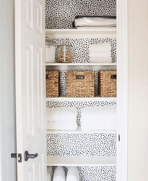 .Wallpapered Linen Closet.