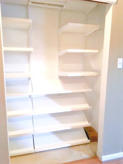 .bare shoe closet.