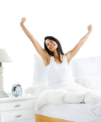 Tired sleepy woman waking up and yawning with a stretch while sitting in bed isolated on w
