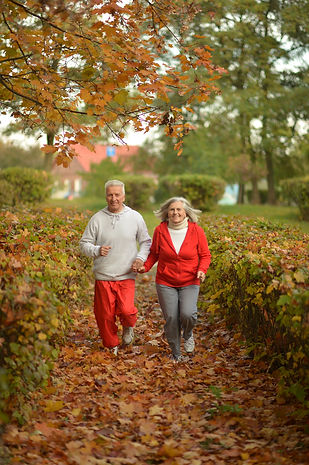 Portrait of a fit senior couple exercising in park.jpg