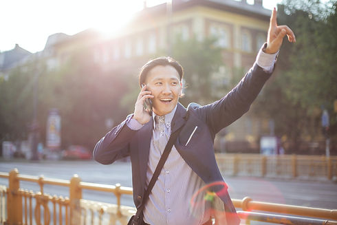 cheerful-asian-businessman-chatting-on-p