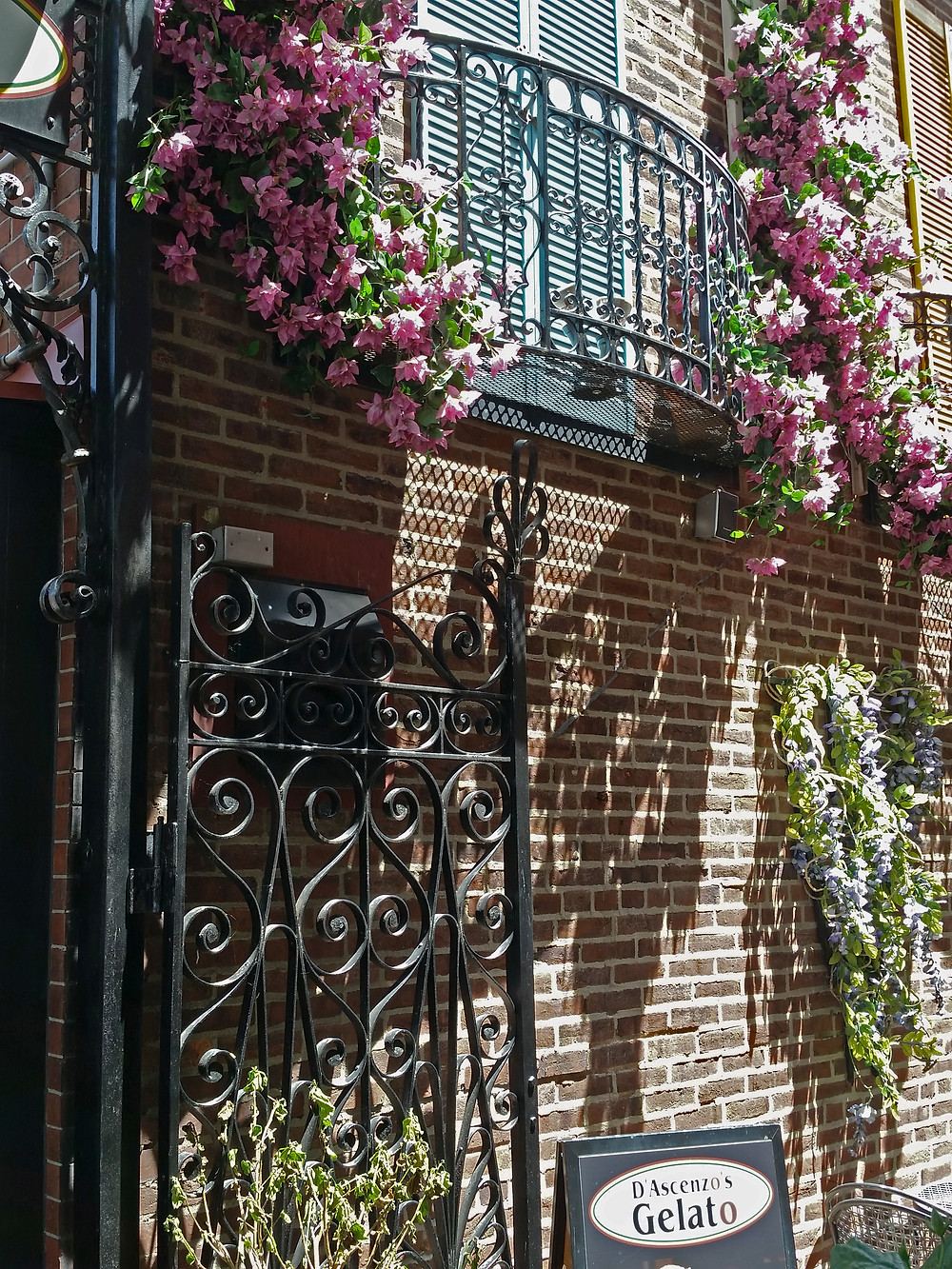 Love those colorful shutters, and that gate!