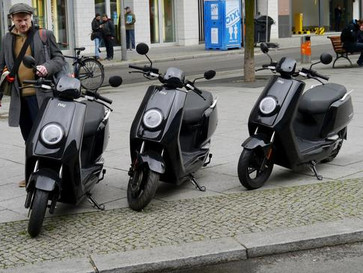 Asian e-scooter race heats up on chilly German streets