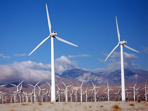 A_close_shot_of_wind_turbines_wind_farm.