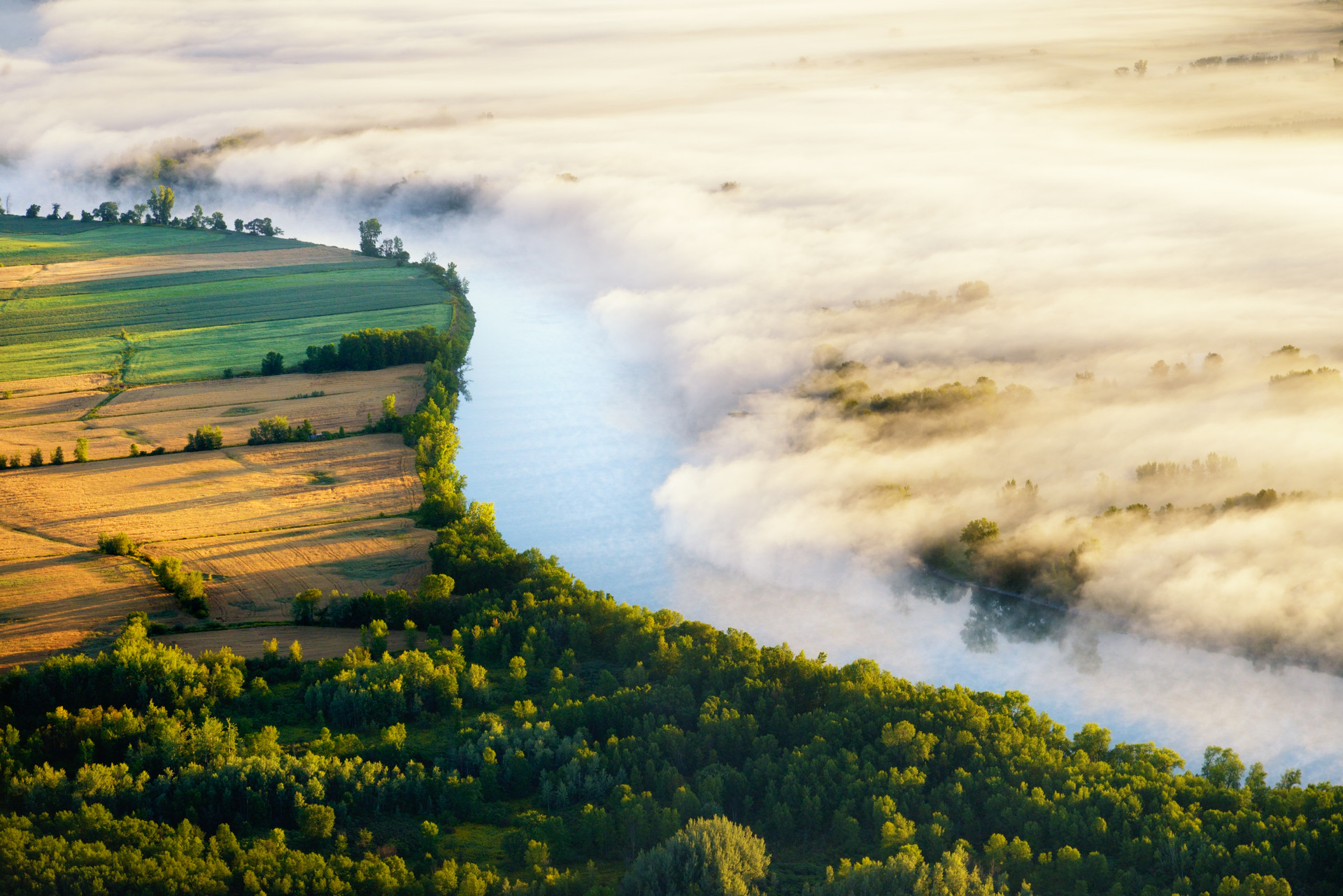 Waking up early has its benefits. You can witness spectacular landscapes such as this one. I captured the fog coming out of the river and being pushed to the side by a light wind. It almost looks surreal. I love being an aerial photographer as I can witness scenes that are not typically seen on the ground. The Richelieu river has offered me many wonderful views that I have captured throughout the years.