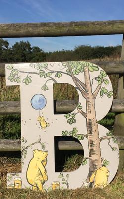 B in classic Winnie the Pooh design