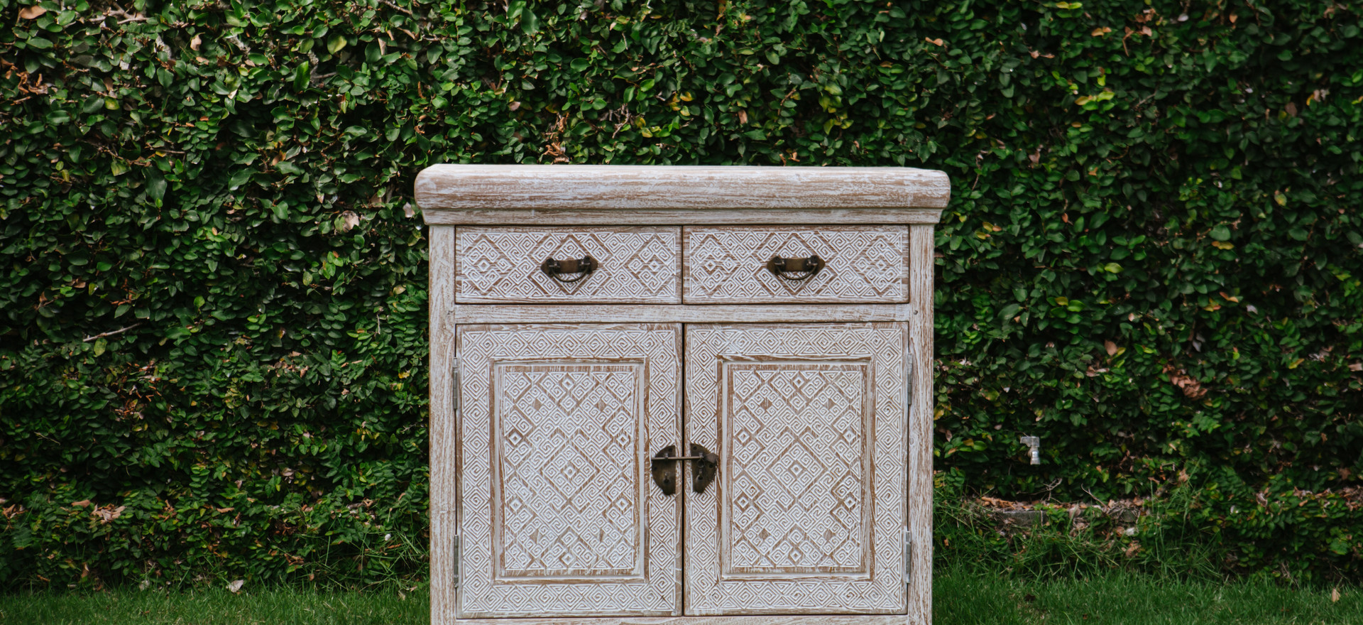 small chest of drawers with a unique lock
