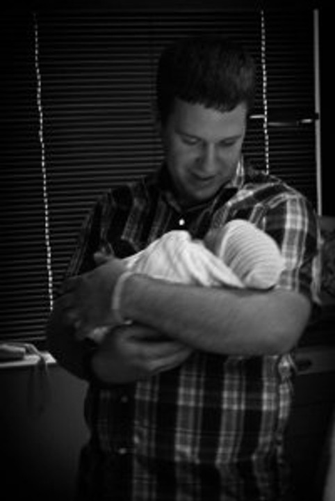 A first-time Dad holding his newborn son