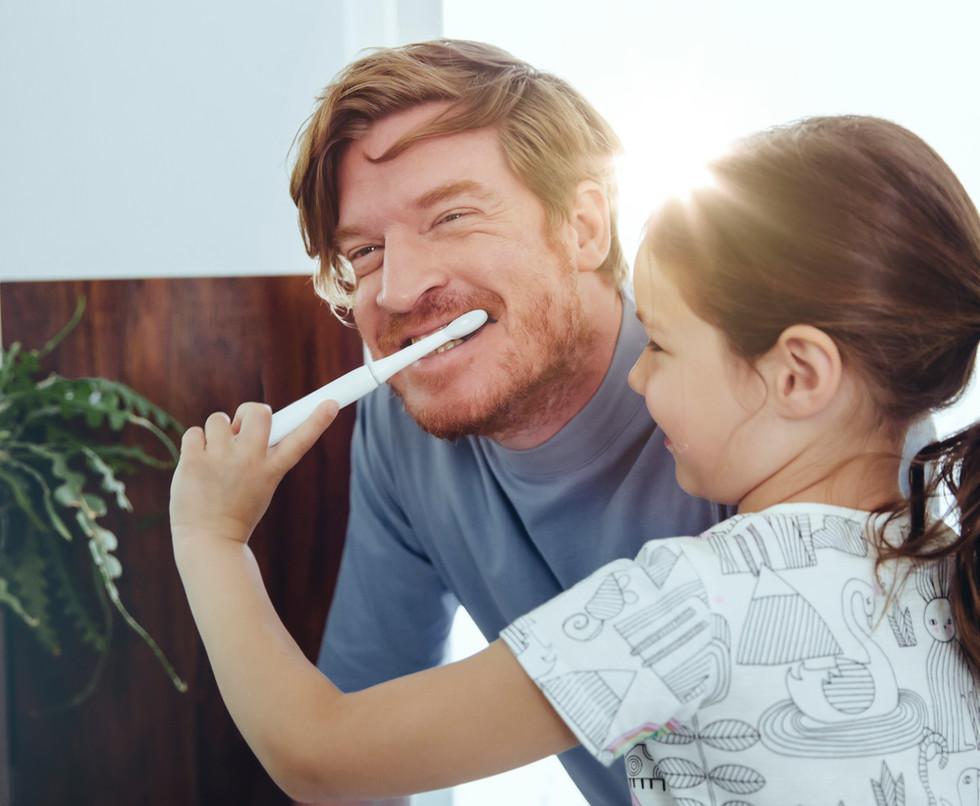 Girl Brushing Dad's Teeth