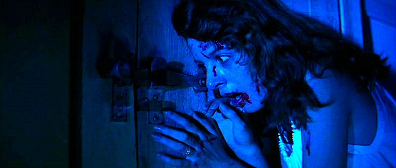 Sara cornered by the forces of evil in Suspiria.