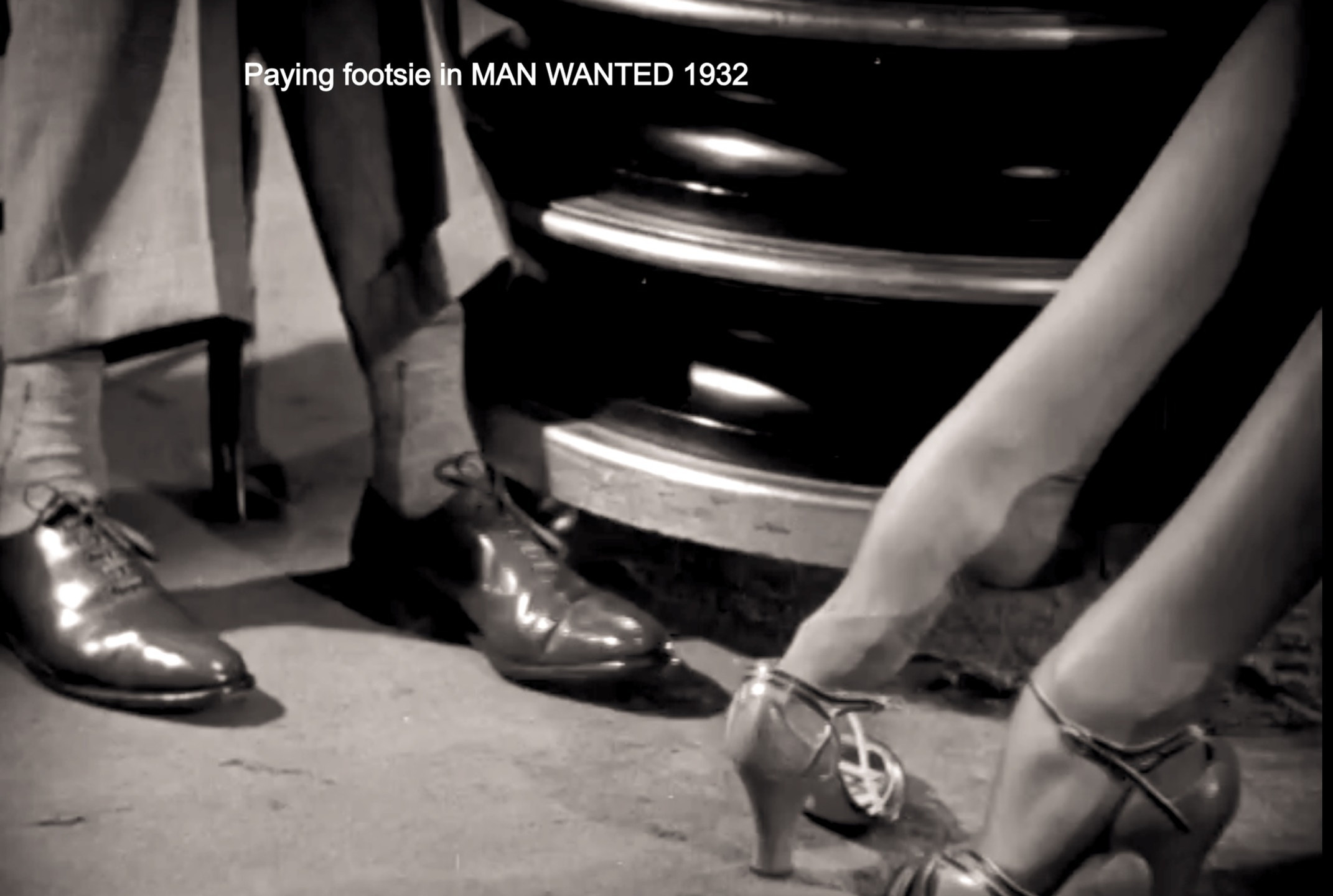 Manners and Francis play footsie in Man Wanted 1932