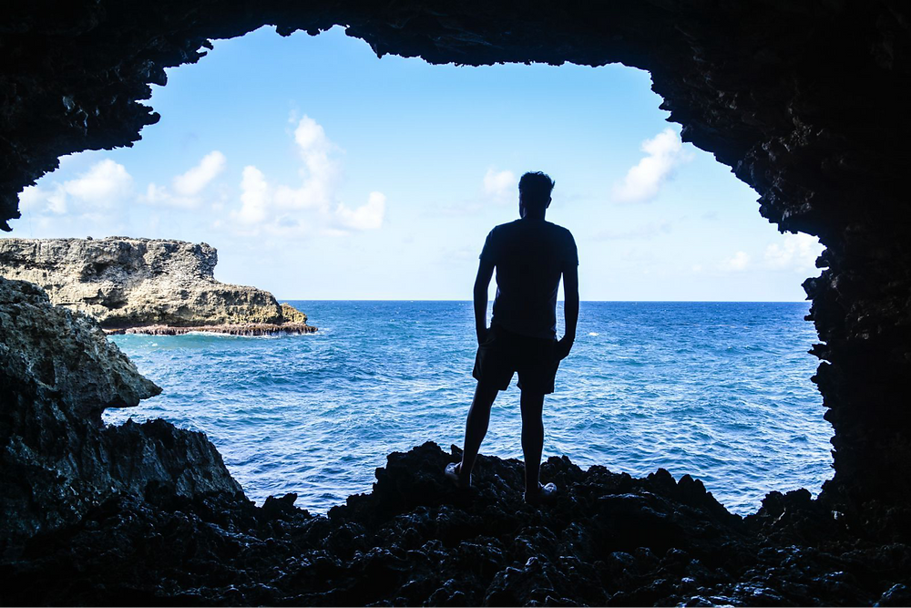 Man standing in the Animal Flower Cave in Barbados