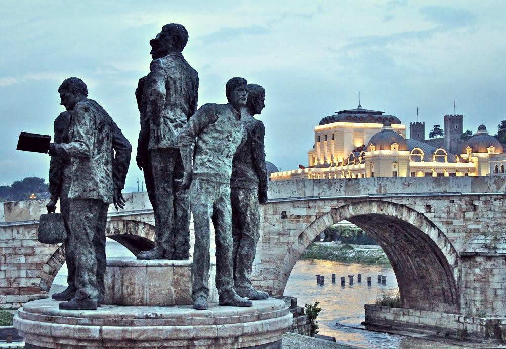Historic statues and bridge in the evening in North Macedonia