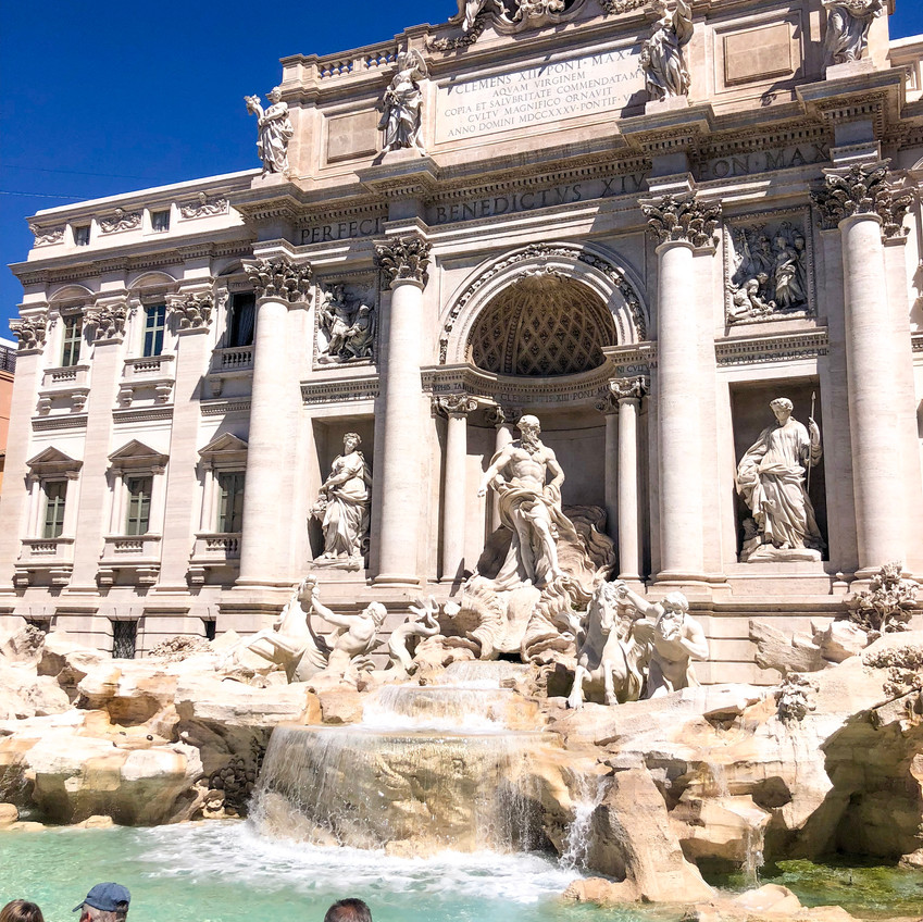 visiting the Trevi Fountain in Rome Italy