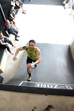 Founder of Woodbox Fitness on the warped wall obstacle
