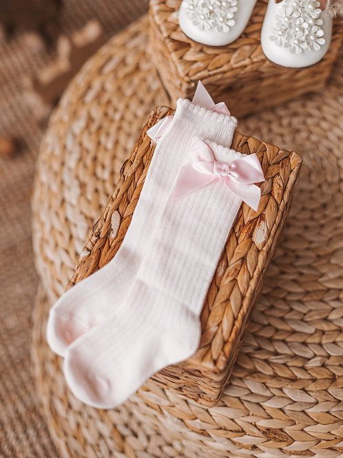 Pink socks with a ribbon