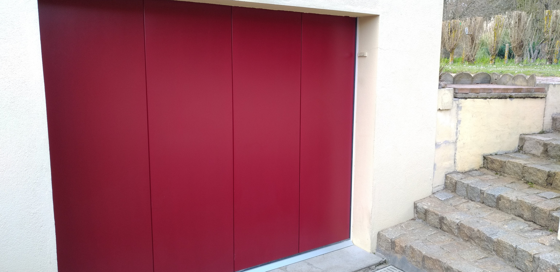 Porte de garage latéral