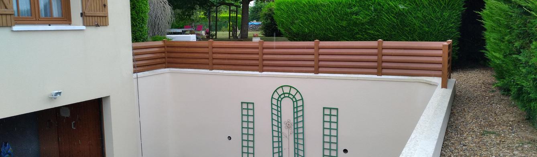 Clôture PVC chêne doré à Villemolle