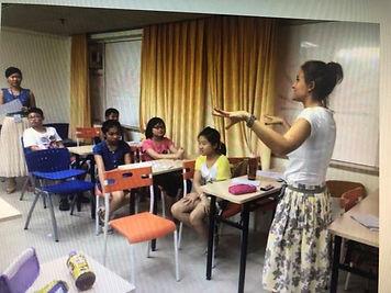 Olya teaching English.jpg