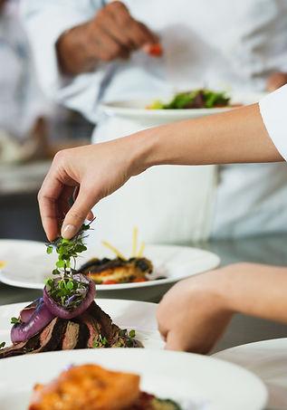 Chef Garnishing a Meal