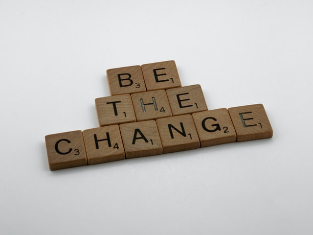 """Scrabble tiles that spell, """"Be The Change."""""""