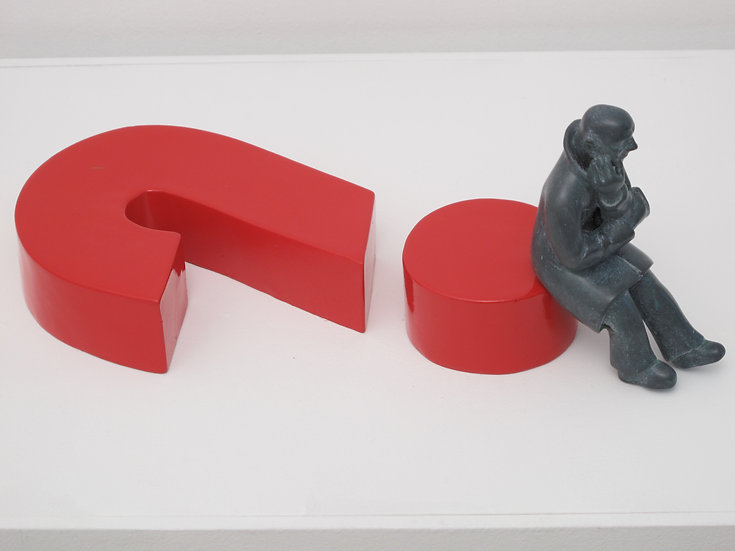 Paralysis (man sitting on question mark)