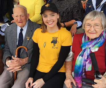 Mr Chuck Younger joint founder of the Goondiwinindi Emus with Secretary Jodie Cairns and his wife at the 2016 Risdon Cup Grand Final.