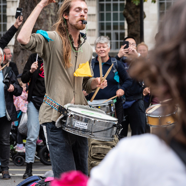 A demonstrator with a tambourine during the October 2019 Extinction Rebellion climate strike