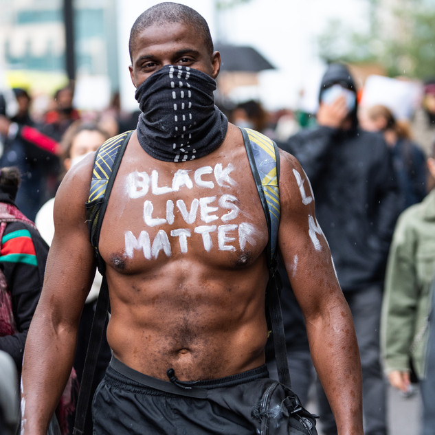 A man shows his solidarity at the June 2020 Black Lives Matter protests