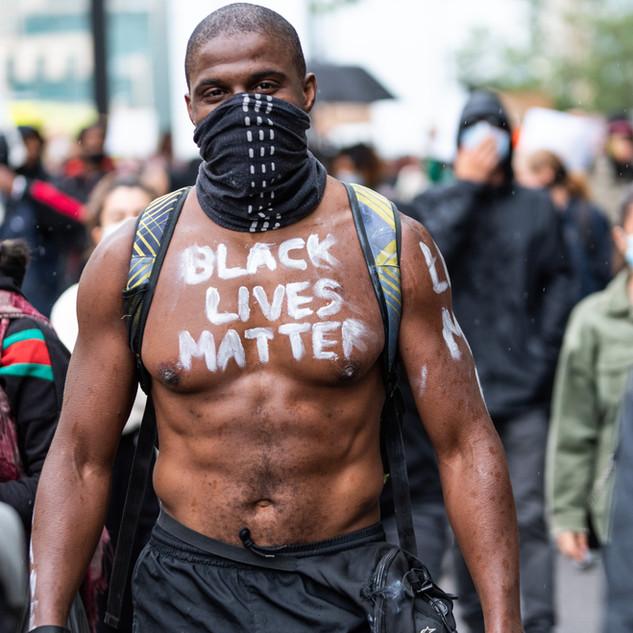 A man shows his solidarity at the June 2020 Black Lives Matter protests