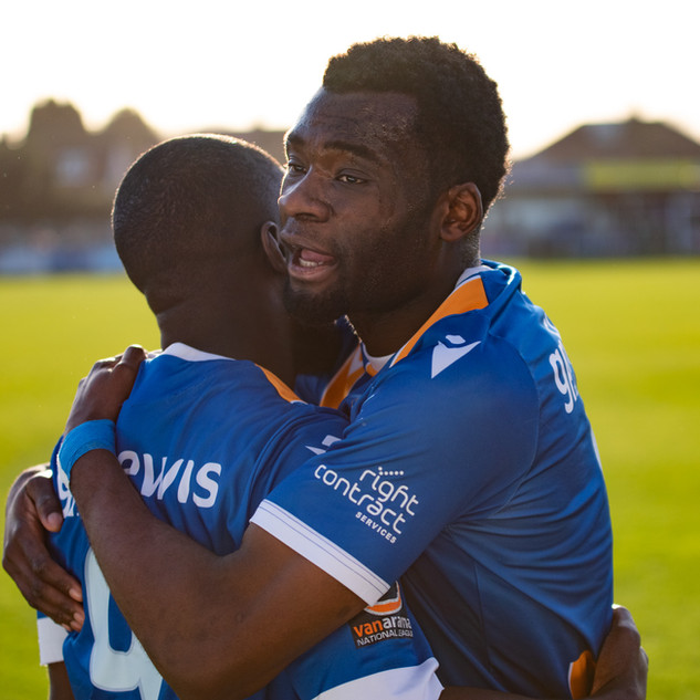 Wealdstone FC defender Michee Efete embraces forward Moses Emmanuel after the first goal against Billericay Town, 8th February 2020