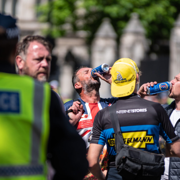 Football Lads' Alliance demonstrators drinking alcohol in front of police blockades