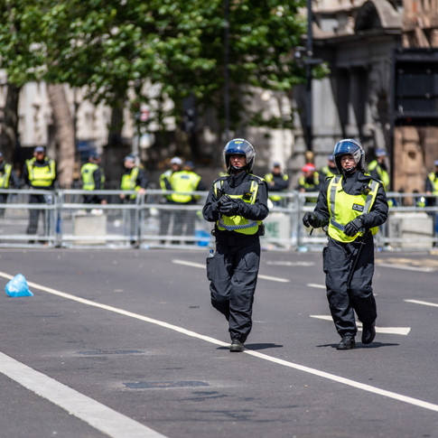 Riot police creating barricades in Whitehall