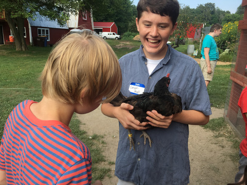 GR Carson and Atticus with a Chicken.jpg