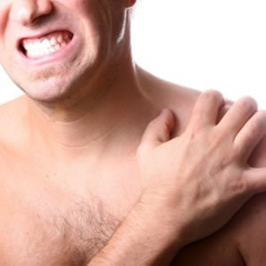 What can be done to restore function of a frozen shoulder?