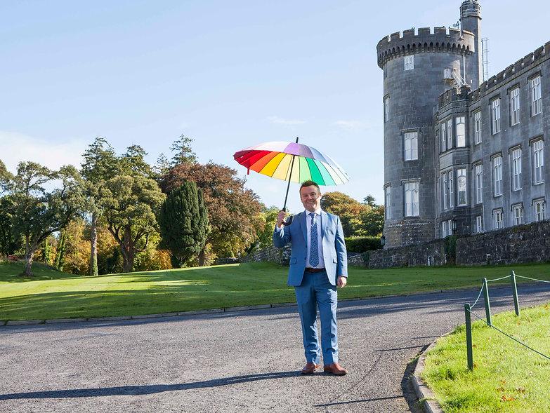 daragh under umbrella outside castle.jpg