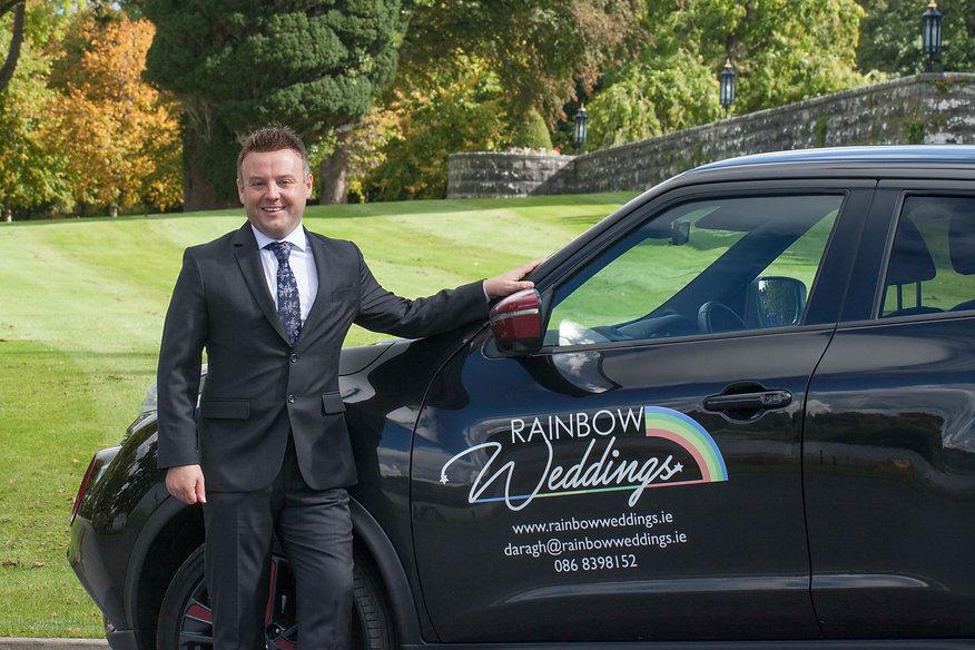 Daragh stood with Rainbow weddings car.j
