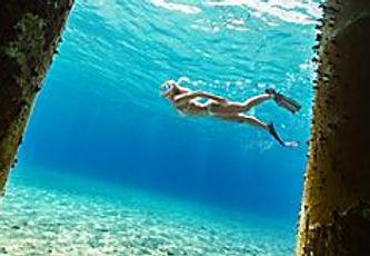 cozumel-mexico-girl-snorkeling-fins.jpg