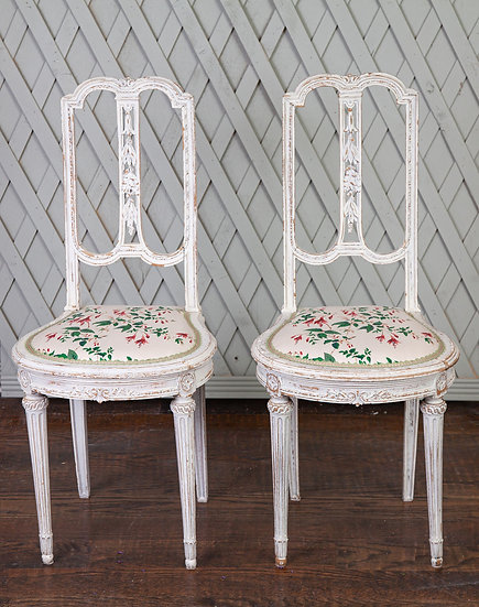 A beautiful pair of French occasional chairs