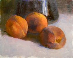 peaches and dark vase