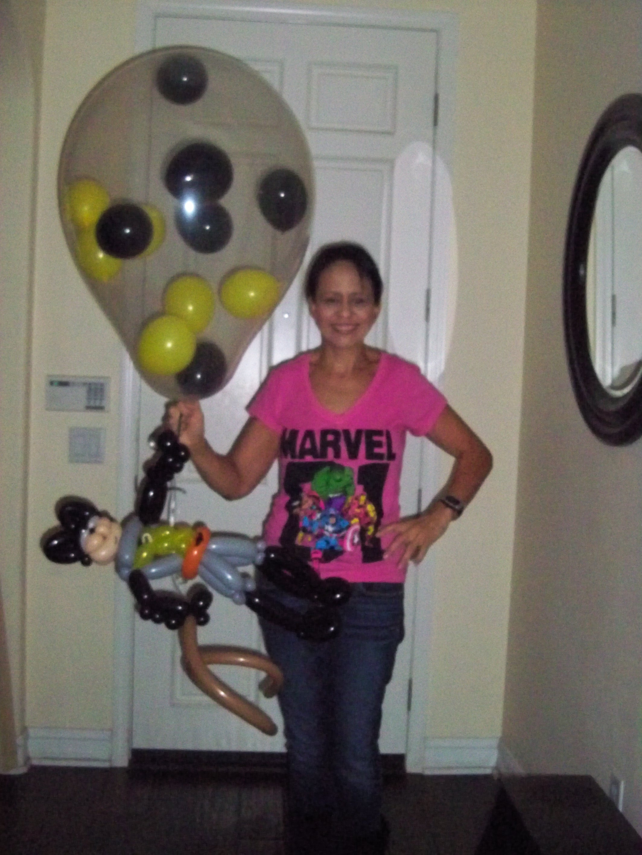 Batman figure and stuffed balloon