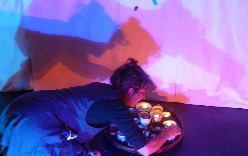 Sally Tennent-Brown installing candles and tea-bags