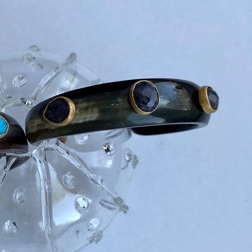 Bone cuff with lapis lazuli stones