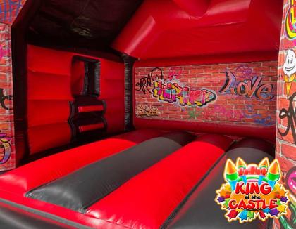 Graffiti Bouncy Castle with Slide