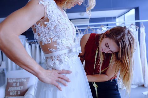 Woman being fitted for wedding dress
