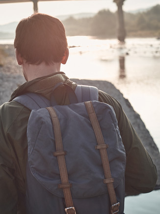 Rear View of Man with Backpack