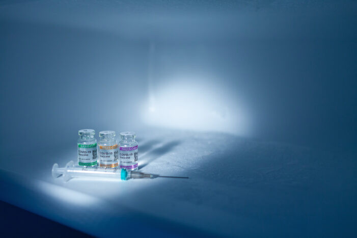 COVID-19-vaccines-and-syringe-701x467.jp